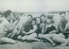 Soldiers with their girlfriends having fun at the beach.