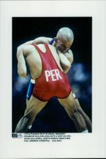 American wrestler Brandon Paulson takes a grip on Joel Basaldua from Peru during the 1996 Olympic Games