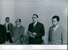Ferhat Abbas holding a paper while delivering his speech. 1960.