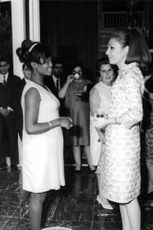 Farah Pahlavi having a conversation to a woman, 1968.