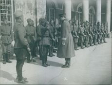 Colonel Procope while guardist inspecting the soldiers at the changing of the noon-guard on the Hauptwache at Helsingfore, Finland. 1919