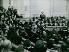 Joseph Kessel speaking in front of the crowd. 1964.