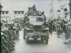 U.S. Troops roll through Oran, 1944.