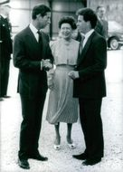 Prince Charles standing and talking with Princess Margaret and Viscount Linley