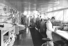 US Navy officers busy in their work.