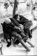 Sleeping veterans on a park bench less than 300m from the Kremlin