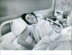 Vintage photo of Nelly Galvan lying in hospital. Photo taken on March 6, 1961.