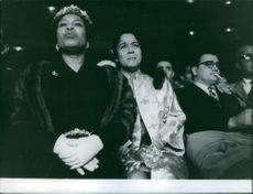 Women look upset during fight of Sugar Ray Robinson.