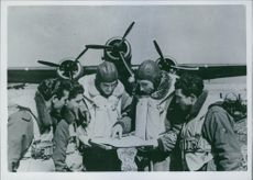 National Institute for Cultural Relations with Foreign Rome - Via Victor N. 2 Photo Service. Torpedo bombers of Sicily about to leave while studying the route.