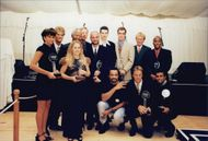 The tennis players with their trophies at a dinner organized by Nelson Mandela in Somerset West after the Nelson Mandela Tribute Tournament
