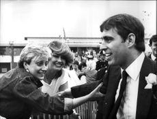 Prince Andrew is attacked by admirers at the opening of an entertainment center named after the Earl Mountbatten