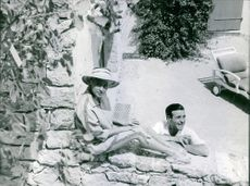 Martine Carol and Christian-Jaque relaxing.