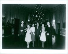 US former president Richard Nixon photographed with his family in front of the Christmas tree.