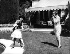 Sophia Loren playing with a kid.