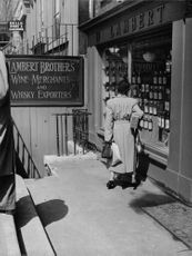 A woman reading board at a wine shop.