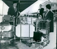 Gaston Naessens with his family standing at airport tarmac.