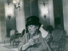 Elsa Maxwell wearing a hat.