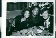 Nicky Blair joins Dionne Warwick and her husband Bill Elliott at the opening of his restaurant.  1971
