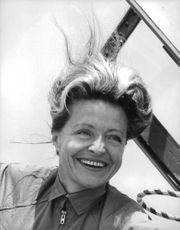 A portrait of the glamorous and smiling French flier,  Jacqueline Auriol.