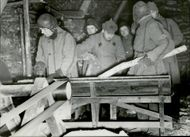 Russian prisoners working together in the camp. 1940