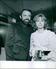 Suzanne Hahn and John Astin standing next to each other and smiling. 1969.