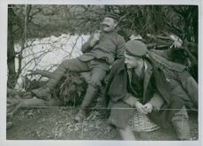 Soldiers resting in the tree brunch during Tyskland war.