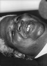 Close-up of Joshua Mqabuko Nyongolo Nkomo, smiling.