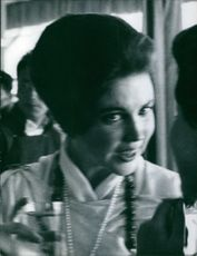 Hope Cooke of Sikkim talking to unidentified woman.