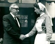 Lord George Brown leaves the hospital after operation