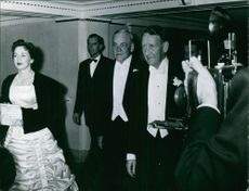 John Foster Dulles arriving at the party with other people.