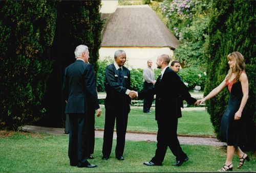 President Nelson Mandela welcomes Andre Agassi and his wife Brooke Shields at a dinner in connection with Nelson Mandela Tribute