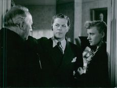 "Åke Claesson, Sture Lagerwall and Gunn Wållgren from the movie ""Resan bort"". 1946."