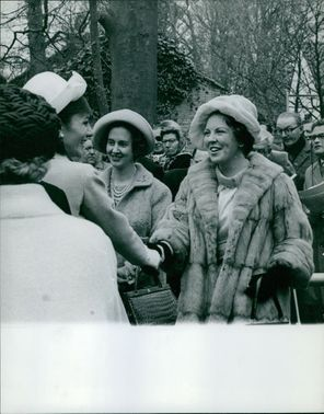 Princess Beatrix shaking hands with a woman. Photo taken May 7, 1962