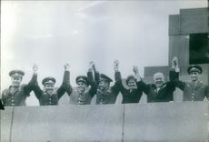 People raising hands after victory.