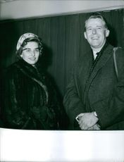 A photo of Princess Alexandra, The Honorable Lady Ogilvy standing beside Angus Ogilvy.