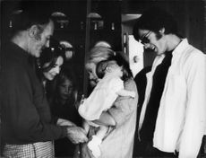 Roger Vadim standing with people.