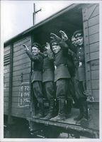Happy soldiers saying good bye from a train in Austria.