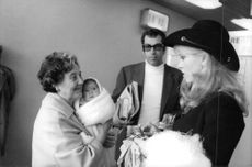 Roger Vadim and Jane Fonda with women carrying baby.