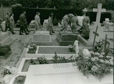 People carrying a coffin inside the cemetery.  Taken - 24 Sept. 1963