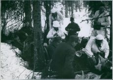 Soldiers gathering round a field kitchen outside Namsos, 1940.