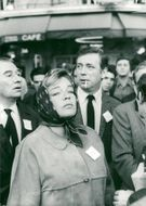 Simone Signoret and Yves Montand participate in a demonstration against the war in Vietnam