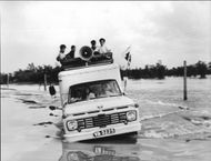 Flooded South Vietnam where Red Cross personnel may use air and boat DEV distribution