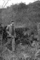 Charles, Prince of Wales walking through forest.