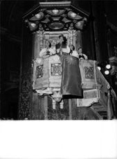 Pope Paul VI standing in building, with people.