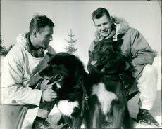 Men with two pet dogs.