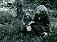 Eva Jakobsson with a child, playing.