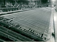 Reinforcement Day at Halmstads Ironworks: Bar by rod in one of the rolling mills, where 41,000 tonnes of hot rolled steel reinforcement steel can cool down a year