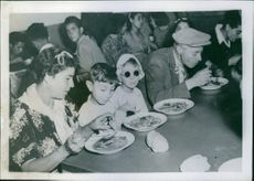 An Italian family is taking a simple meal, Allied military government cares for Italian refugees