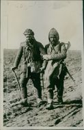 Two balkan soldiers walking holding each other. 1913