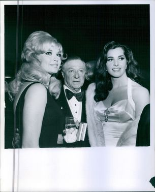 George with two ladies at a party.